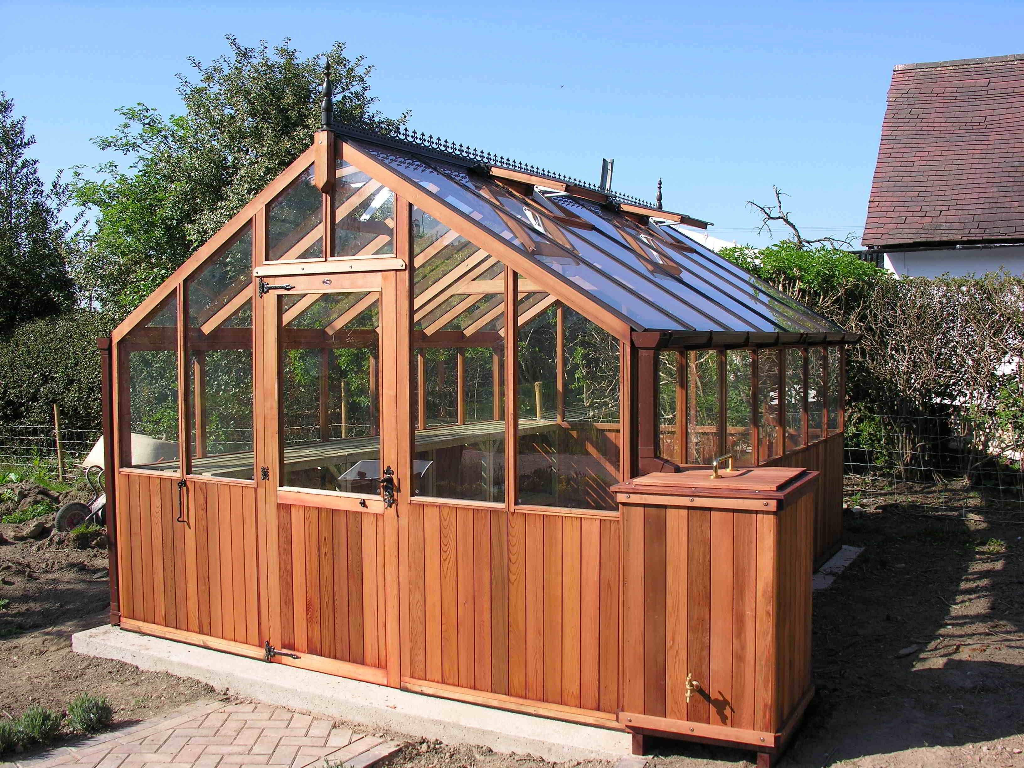 Bromley greenhouse 14 x 12 with contemporary waterbutt