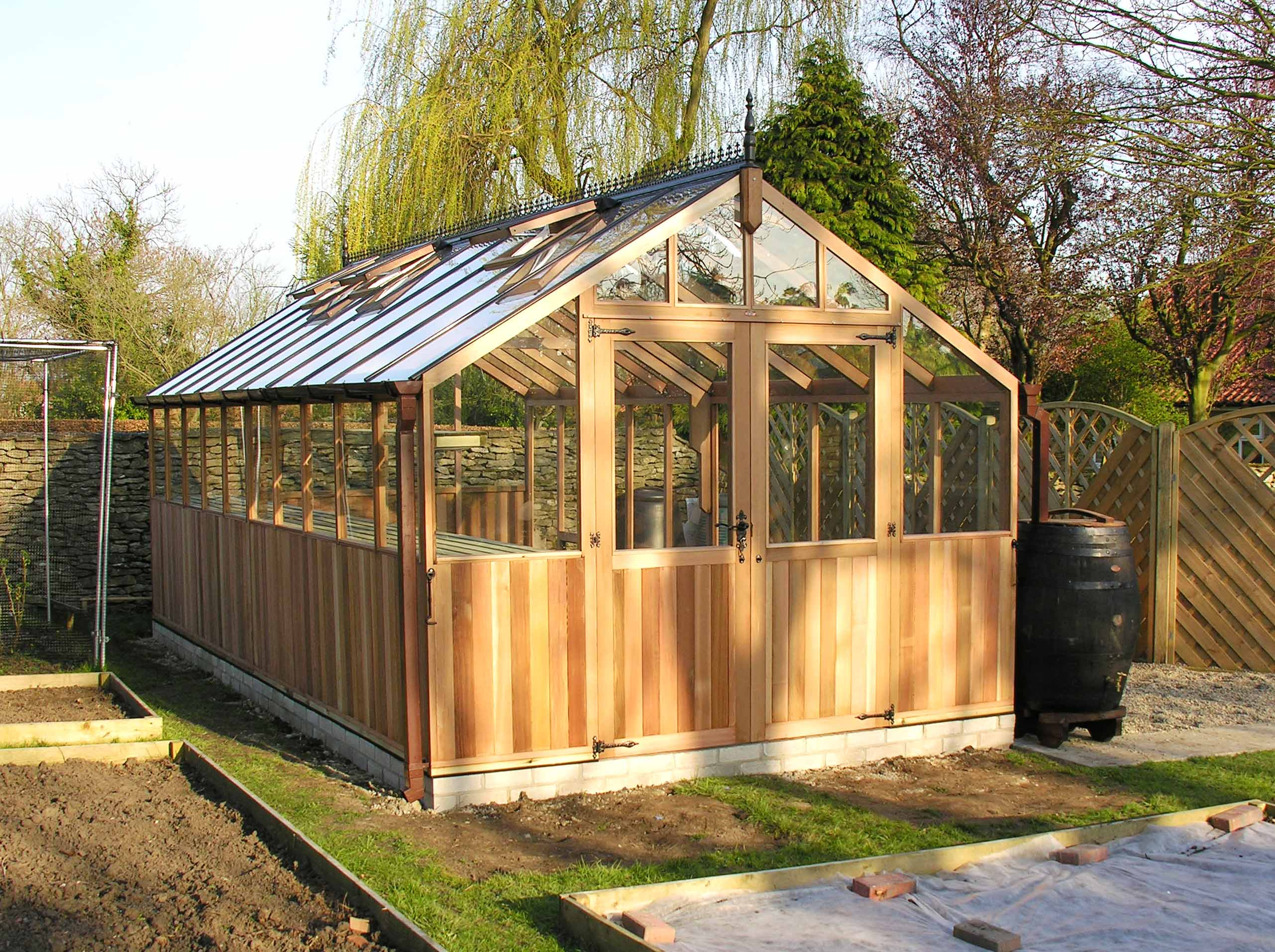Cedar greenhouse double doors in gable