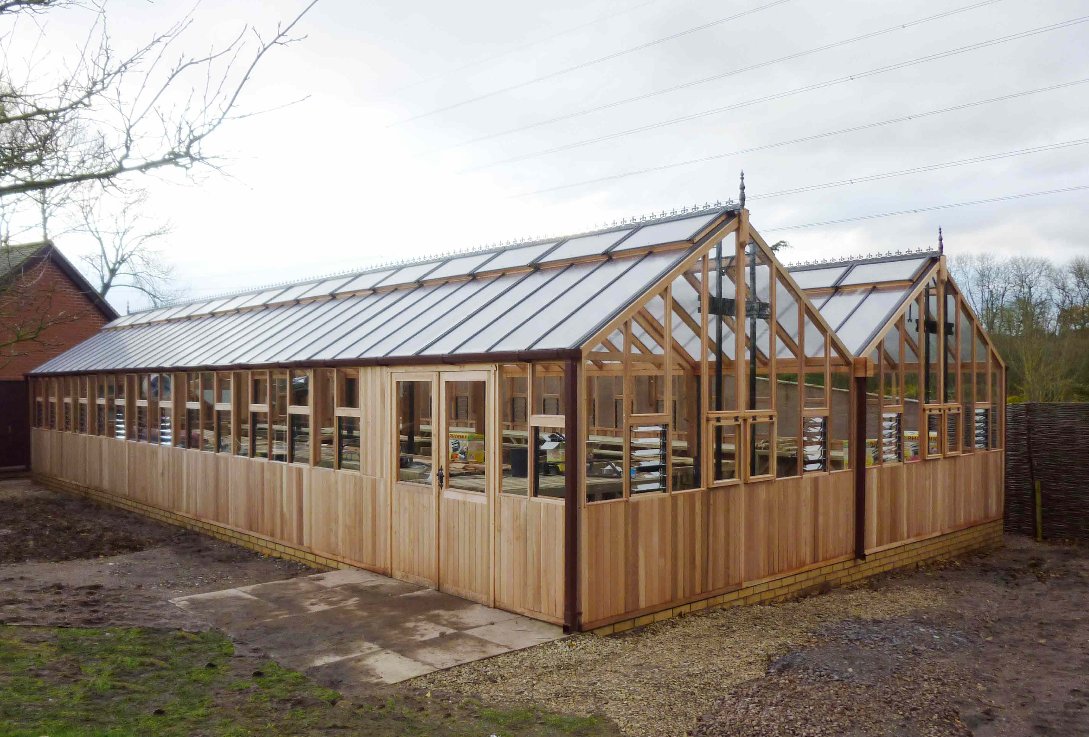 26ft x 56ft Western Red Cedar twin gable commercial greenhouse