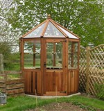 Cedar greenhouse for a smaller garden