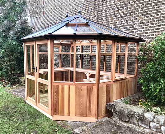 large round Cedar Greenhouse 12ft x 10ft wooden greenhouse for garden focal point