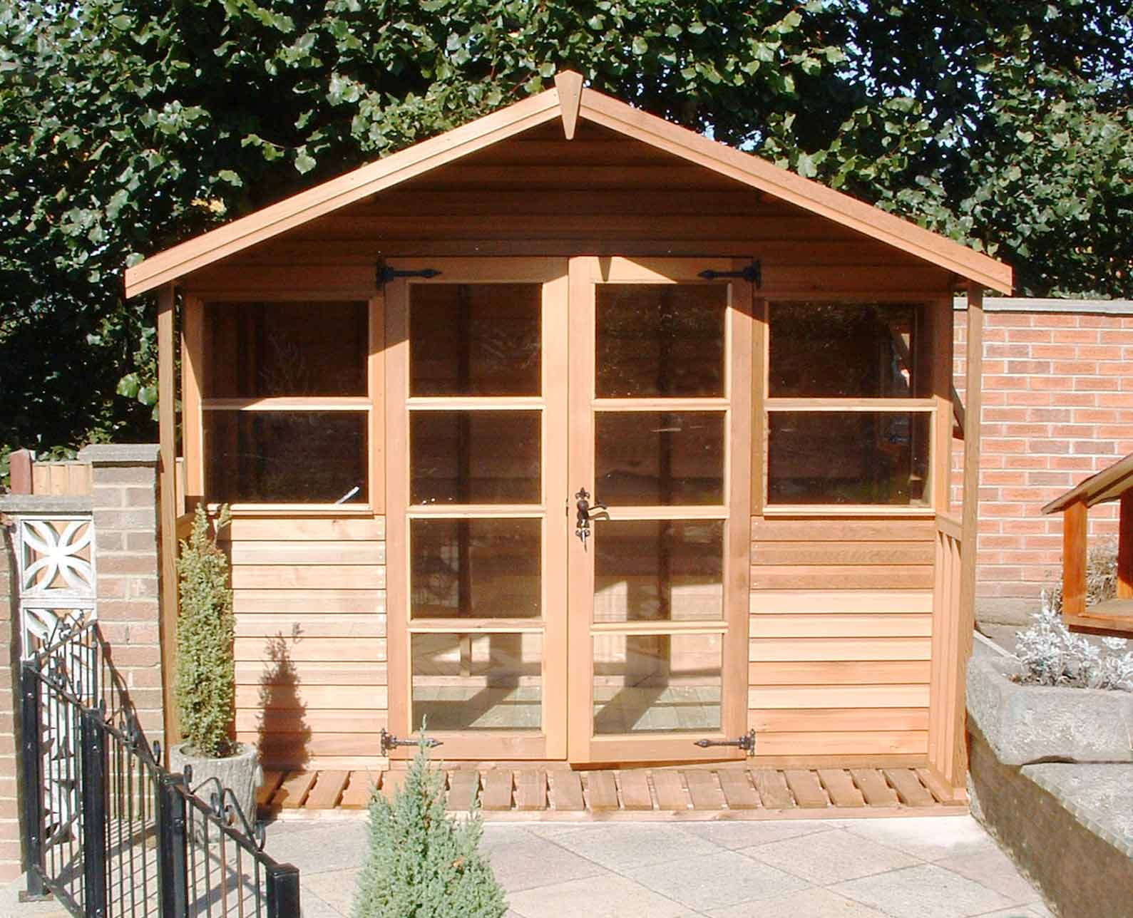 traditional cedar summerhouse installed and delivered - Garden Sheds With Veranda