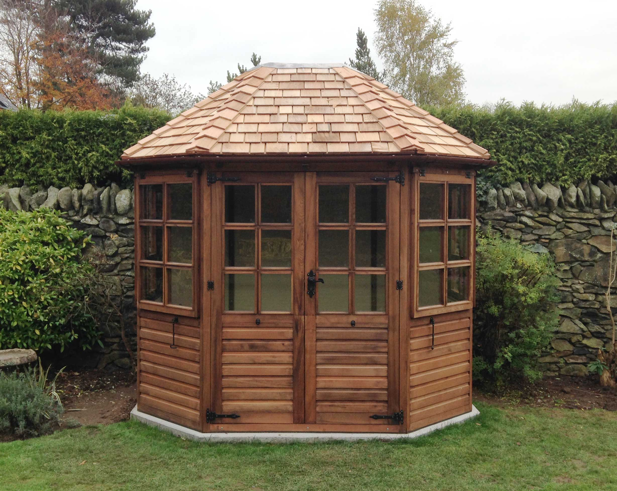 Octagonal summer house woodpecker joinery uk ltd for Garden designs with summer house